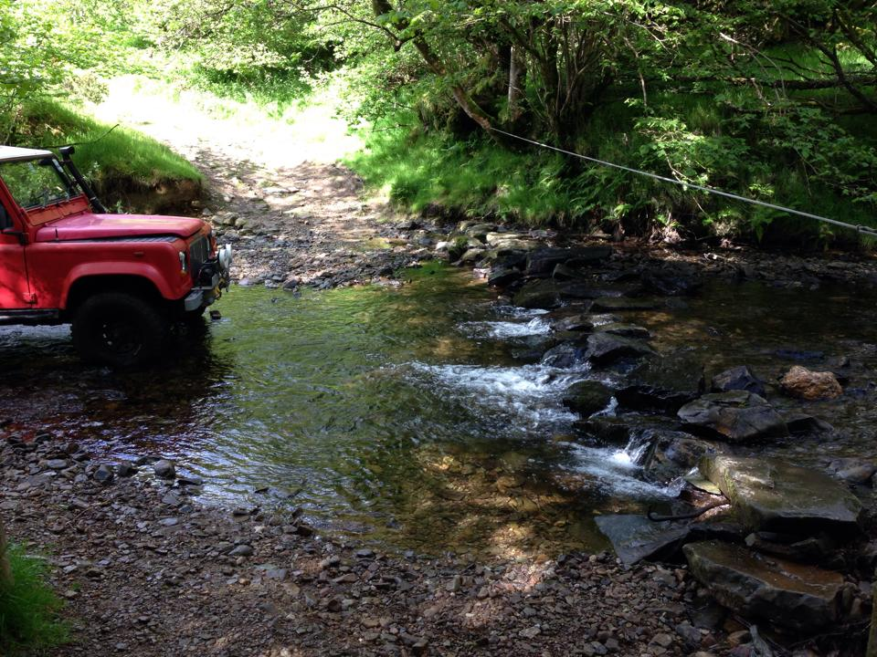 Adjusting the stepping stones with a Land Rover and winch